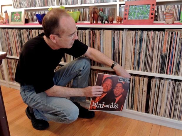 Pollard sorting through his vast LP collection.